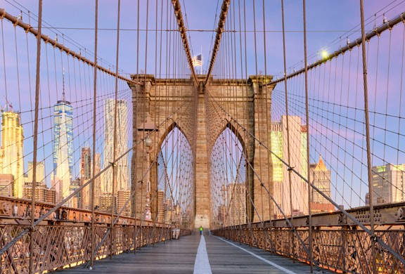 brooklyn bridge at dawn with blue and purple sky